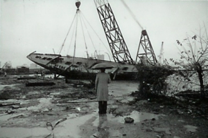 A bystander looks on as the Schooner Atlantic is scrapped...