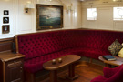 The schooner Atlantic, cosy seating in the lounge area of the saloon...