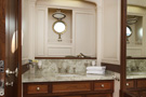 The schooner Atlantic, luxury guest bathroom with stone basin surround...